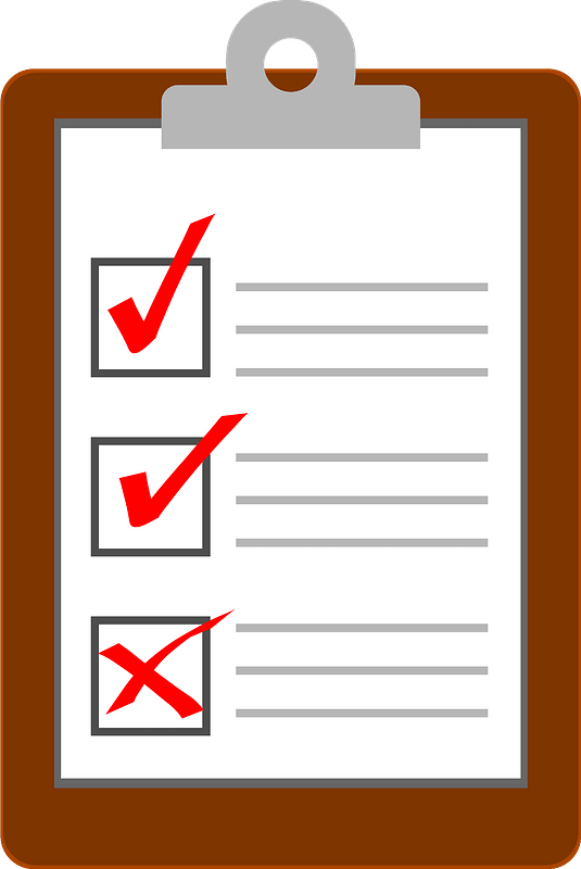 clipboard with lined paper and red checkmarks